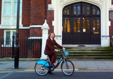 Coleman travelling by 'Boris Bike'. He is based at University College, London until 2016 (Image: UCL History).