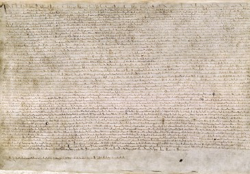 The Magna Carta (originally known as the Charter of Liberties) of 1215, written in iron gall ink on parchment in medieval Latin, using standard abbreviations of the period, authenticated with the Great Seal of King John. [Wikimedia: Public Domain]
